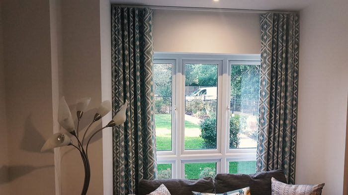 Surrey, fitting curtains and blinds
