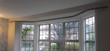 Bay window curtain pole top fixed to ceiling