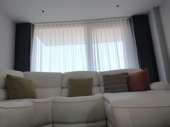 Made to measure curtains and sheers with wave heading to ceiling mounted curtain track