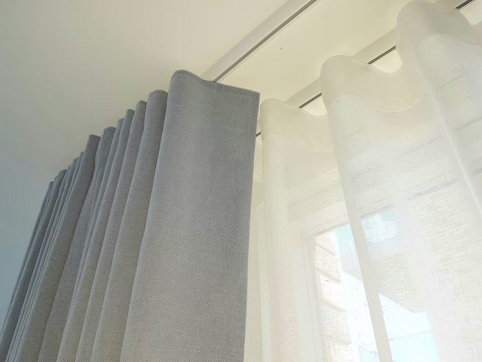Wave curtain sand sheer heading and rail close up