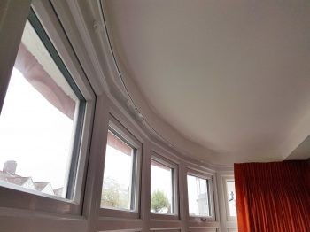 Double pleat curtains hung and dressed to white corded Silent Gliss rail