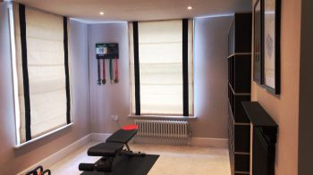 Light Roman Blinds with dark stripes on sides