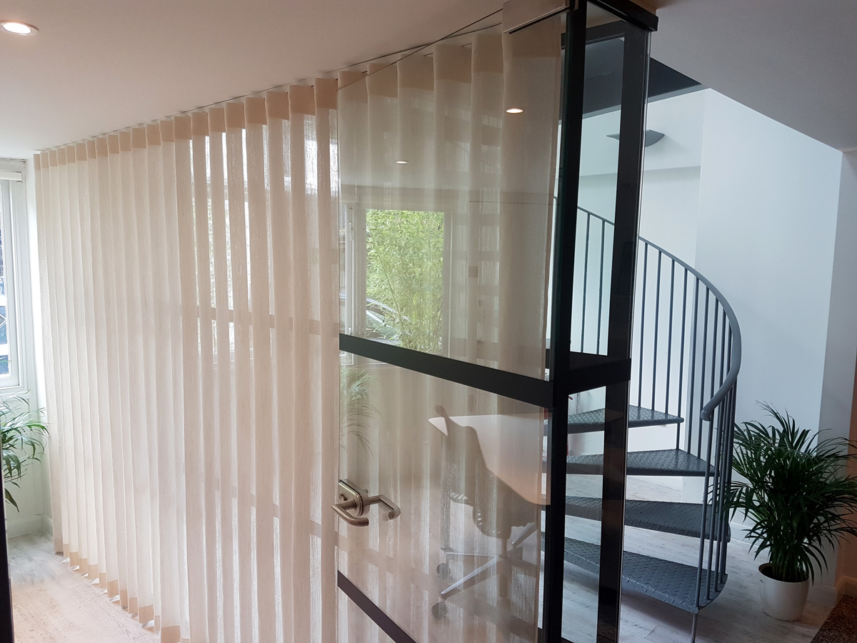 Curtain track and curtains in the office