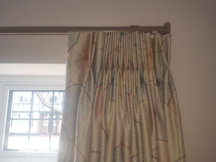 Close up of double pleat curtain to 30mm corded curtain pole