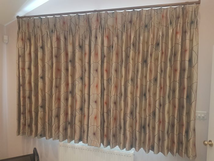 Corded 30mm satin curtain pole with stud finial fiitted to Wall. Double pleat embroidered curtains in contemporary design from style library