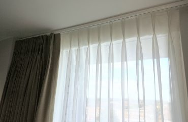 Classic double pleat sheer curtain heading to a handrawn curtain track