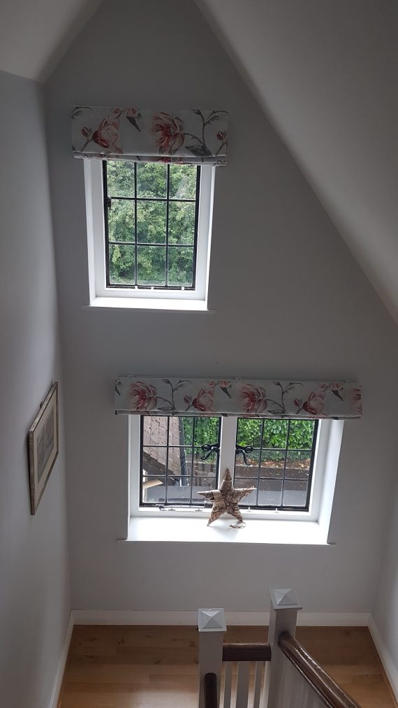 Roman blinds in embroidered flower fabric