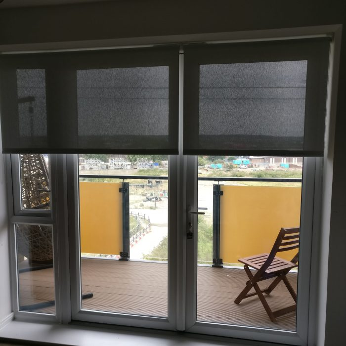 Silent Gliss roller blinds in Alu screen part down position